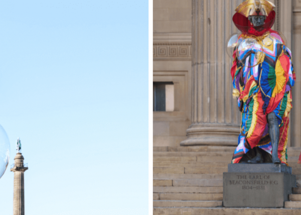 To the left of the image shows a statue outside St Georges Hall dressed up.